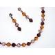 Súprava náhrdelníka a náušníc z krištáľových guličiek navlečených na  lanku.